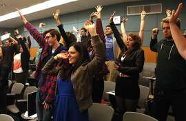 Kent Stanton (left w/glasses) and Alexis Brake (front middle) stretch every 30 minutes while taking the class, Holistic Health 380:   Western Perspectives, at San Francisco State University in California on Monday, August 26, 2013.