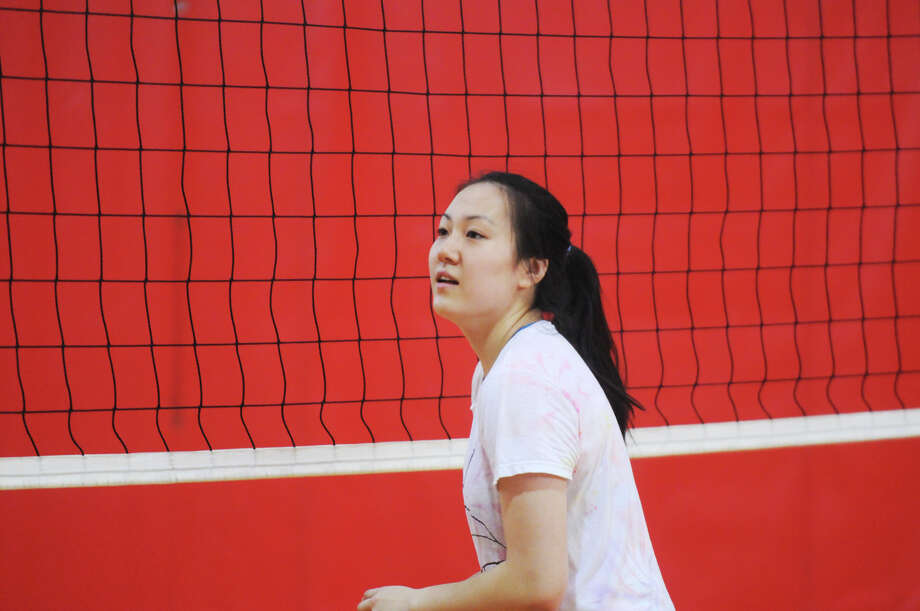 The Greenwich High School girls volleyball team captain Mirei Kato practices with the team at the school in Greenwich, Conn., August 30, 2013. Photo: Keelin Daly / Stamford Advocate Freelance