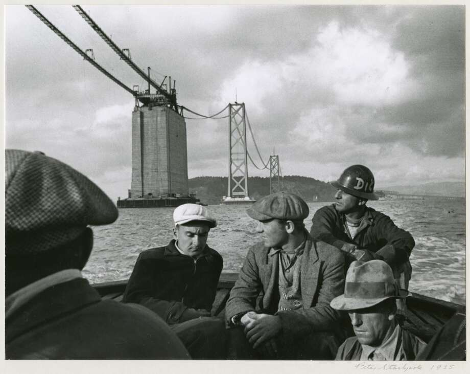 Peter Stackpole's ''Quitting Time'' taken in 1935. The partially constructed Bay Bridge looms in the background. Photo: Peter Stackpole, OMCA