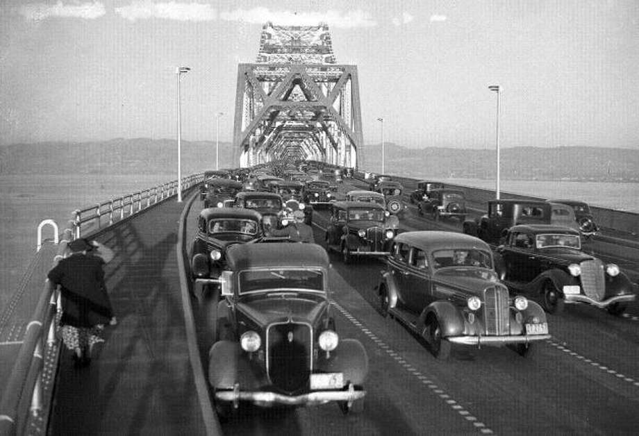 Nov. 12, 1936: In the first 24 hours, 120,000 cars crossed the brand-new Bay Bridge. Upper deck traffic went in two directions until the 1960s. Photo: Chronicle File