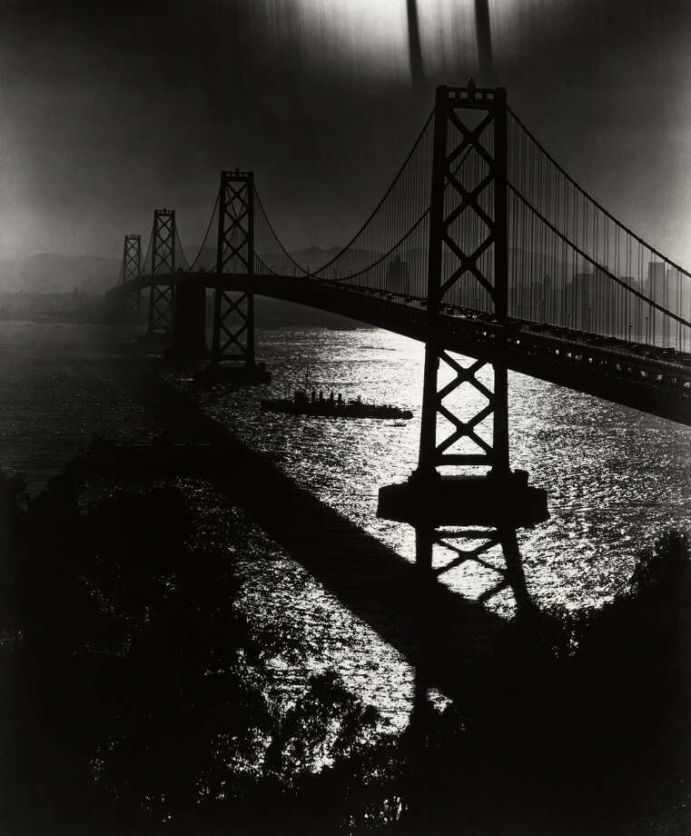 Circa 1936: A view of the San Francisco Bay Bridge in silhouette with a ship traveling beneath it. Photo: American Stock Archive, Getty Images