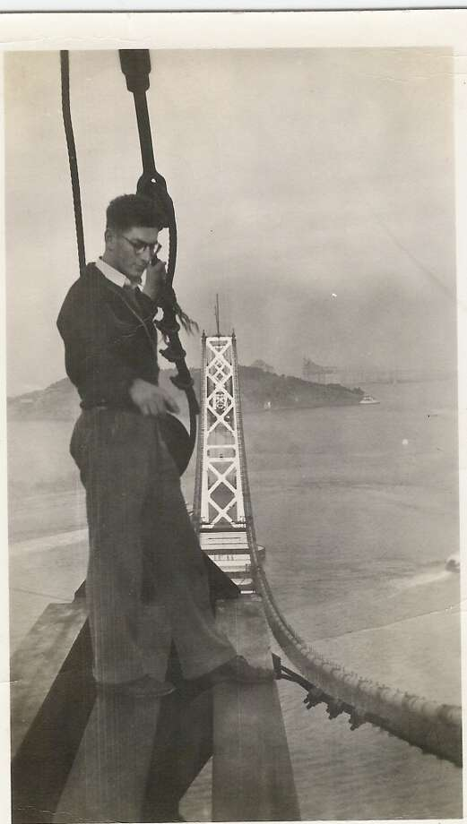 San Francisco daredevil Ray Fross atop a tower of the Bay Bridge in 1935. Photo: Tom Devine, Courtesy Robin Fross