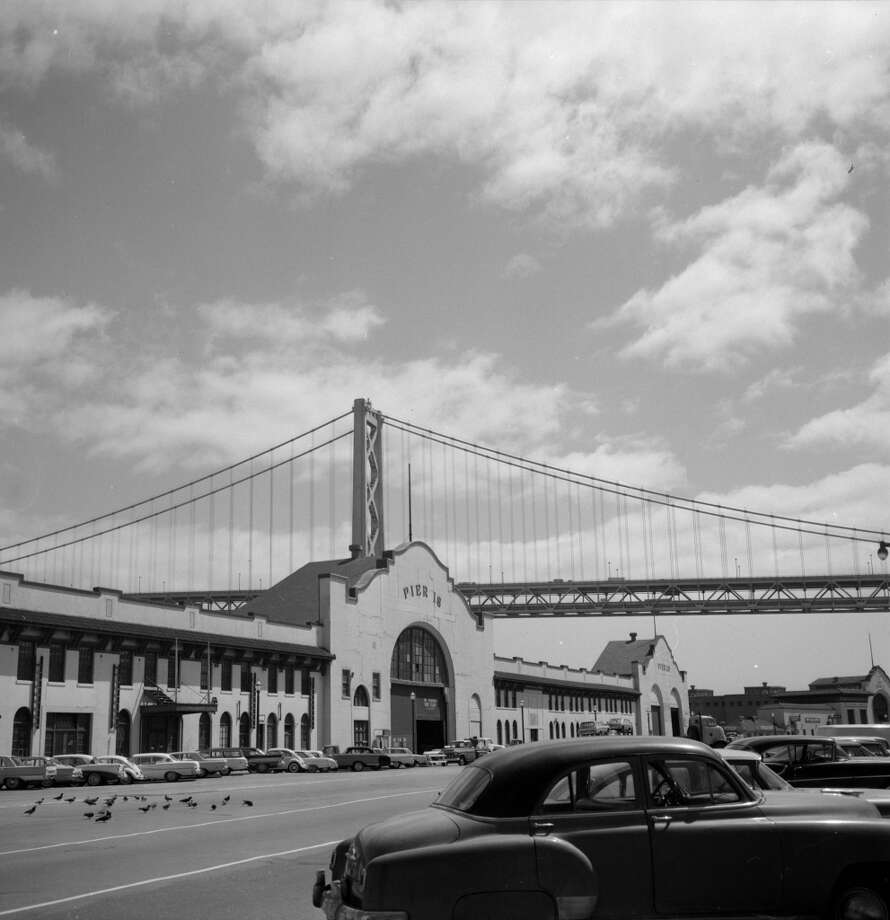 1964:  The western span of the Bay Bridge looms over the Embarcadero. Photo: Roger Viollet, Roger Viollet/Getty Images