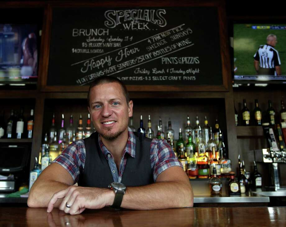 Robby Cook, bartender at JBlack's, who was just named Houston's Most Imaginative Bartender at JBlack's bar, Wednesday, Aug. 28, 2013, in Houston. The contest was sponsored by Bombay Sapphire gin, and he will go on to compete with 50 other mixologists who will compete for a national prize (and a spot on the cover of GQ) in Las Vegas next month. ( Karen Warren / Houston Chronicle ) Photo: Karen Warren, Staff / © 2013 Houston Chronicle