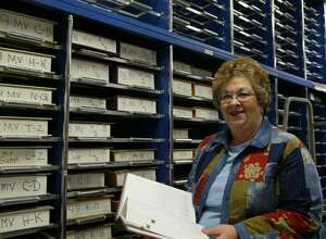 Milford, Tax Collector, Judy Haley goes through a record check in the vault at the Parsons Government Center. Wednesday, Jan. 20, 2010.
