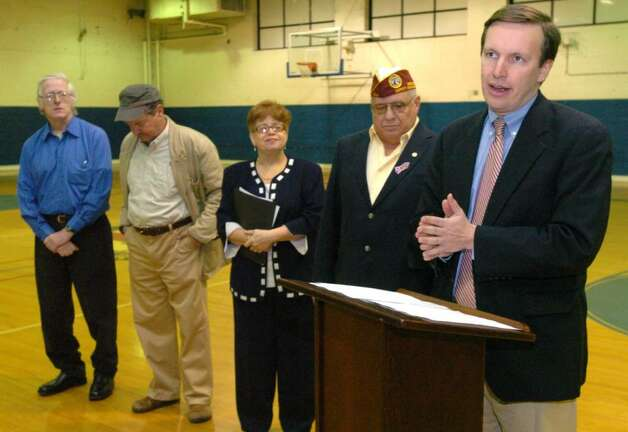 From right, Congressman Chris Murphy, Al Church, Executive Director of Connecticut DAV, Jeanette Diaz, Associate Director of VA Connecticut Healthcare System, Paul Valeri, President of Non-Profit Development Corporation of Danbury and Ray Brandtmeyer, Danbury veteran who uses DAV van service, attend a press confrance at the Danbury War Memorial in Danbury Friday, Jan. 22, 2010. Photo: Chris Ware / The News-Times
