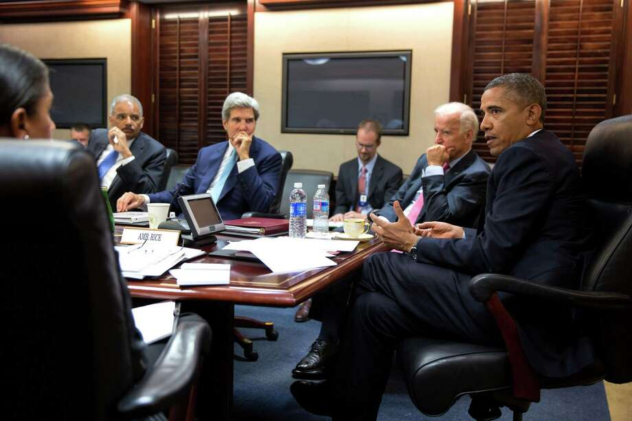 In this image provided by The White House, President Barack Obama meets with his national security staff to discuss the situation in Syria, in the Situation Room of the White House, Friday, Aug. 30, 2013, in Washington, including from left national security adviser Susan Rice; Attorney General Eric Holder, Secretary of State John Kerry, and Vice President Joe Biden. Photo: The White House, Pete Souza