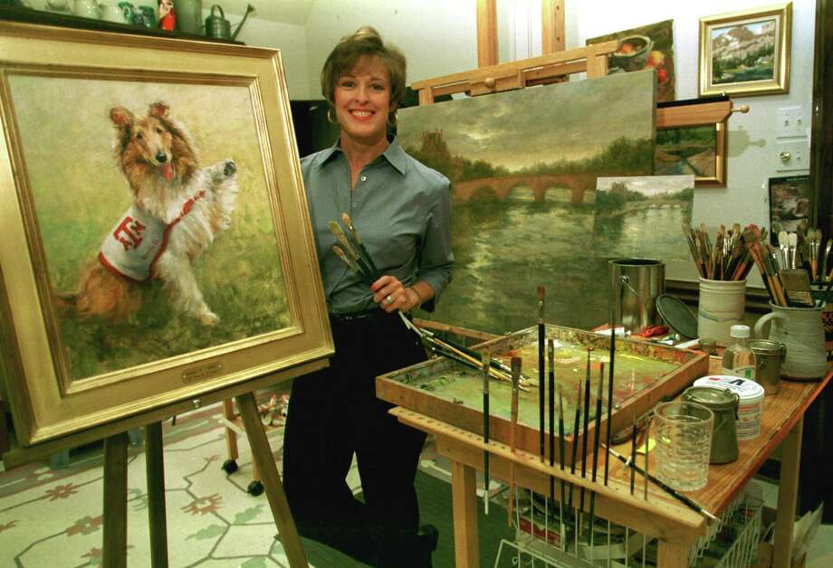 Artist Mary K. Forshagen with her Reveille painting in 2001. The portrait of the Texas A&M mascot was donated to Gov. Rick Perry.   Photo: Kim Christensen, SPECIAL TO THE CHRONICLE / FREELANCE