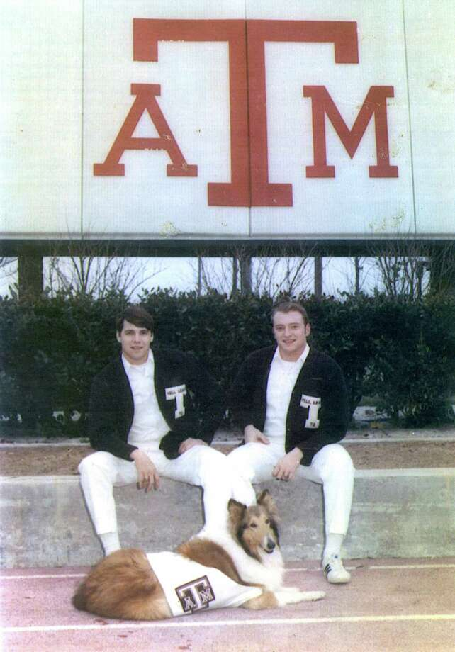 This 1971 provided by the Perry Campaign shows Texas A&M University yell leaders Rick Perry, left, and Tommy Orr with dog Reveille III, the TAMU mascot, at College Station, Texas. (AP Photo/Perry Campaign) Photo: Associated Press / Perry Campaign