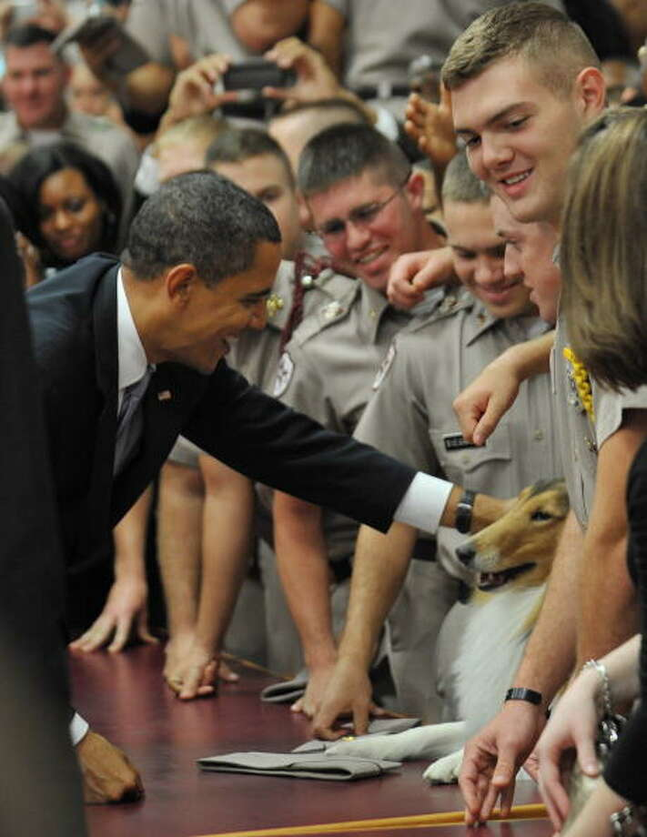 President Obama greets Reveille during while visiting cadets at Texas A&M in 2009. Photo: MANDEL NGAN, AFP/Getty Images / 2009 AFP
