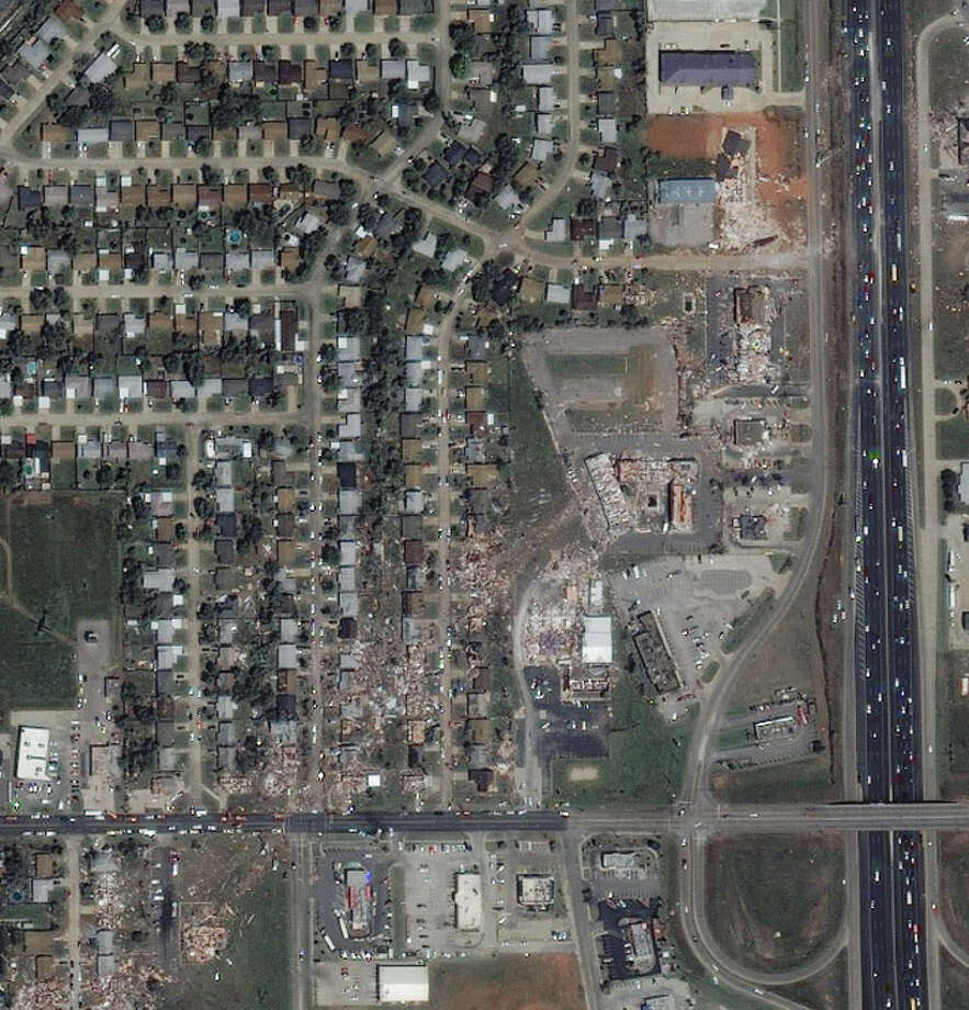 The 2011 Moore tornado cut through the town, as seen in this picture. Homes in the tornado's path were totally destroyed (NASA).