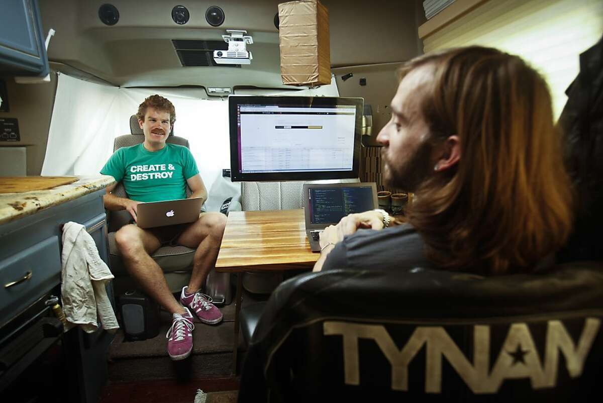 Todd Iceton, left, and Tynan, co-founders of real-time social blogging platform SETT, work in Tynan's RV on Tuesday, July 2, 2013 in San Francisco, Calif.