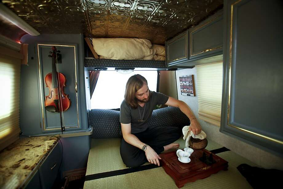 Tynan Smith, who lives in a Winnebago that he parks in San Francisco's Castro district, takes a tea break. Photo: Russell Yip, The Chronicle