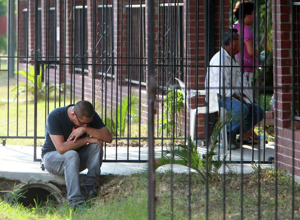 Velasquez mourns at his grandfather's home. Deputies also found Campos' Chihuahua near him.