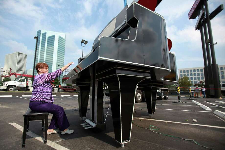 Joyce Cochran, retired Music Director at Fort Bend Music Center, attempts to play the restored oversized Yamaha piano as request from staff on Friday, Aug. 30, 2013, in Houston. Photo: Mayra Beltran, Houston Chronicle / © 2013 Houston Chronicle