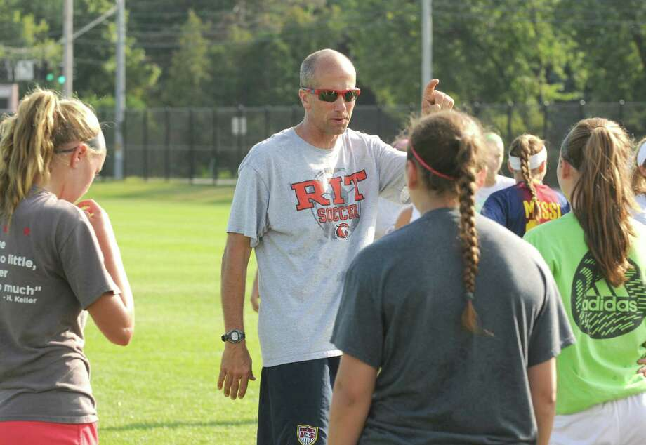 Niskayuna High School girls soccer coach Bryce Colby runs his team practice on Thursday Aug. 29, 2013 in Niskayuna, N.Y. (Michael P. Farrell/Times Union) Photo: Michael P. Farrell / 00023643A