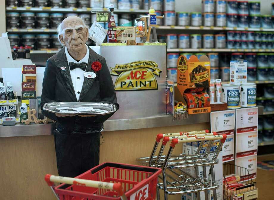 A statue of an Ace butler is in the paint department at a Renco Ace Hardware store in Bloomsburg, Pa. U.S. consumer spending showed weak growth in July. Photo: Ty Wright / © 2013 Bloomberg Finance LP