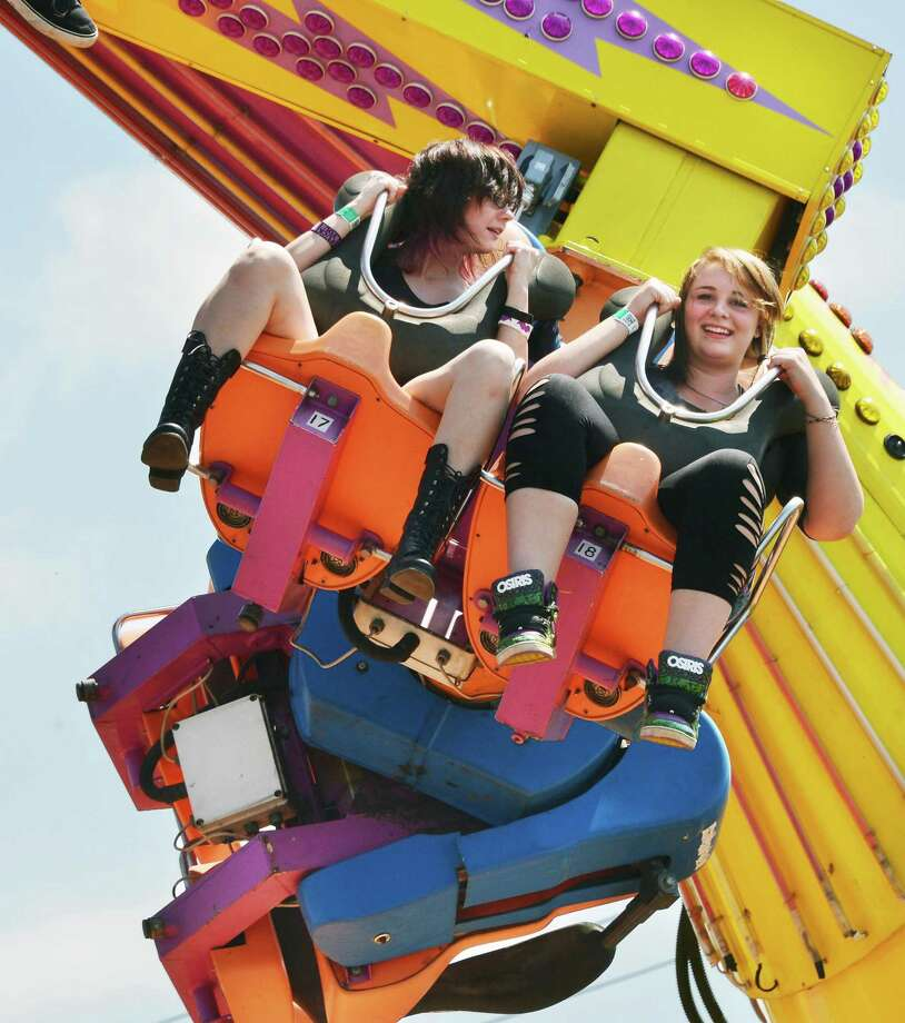 Paige Marie, 16, left, and Allyssa Daniels, 18, both of West Burke, Vt., ride the Power Surge at the Schaghticoke Fair Friday Aug. 30, 2013, in Schaghticoke, NY.  (John Carl D'Annibale / Times Union) Photo: John Carl D'Annibale / 00023179A