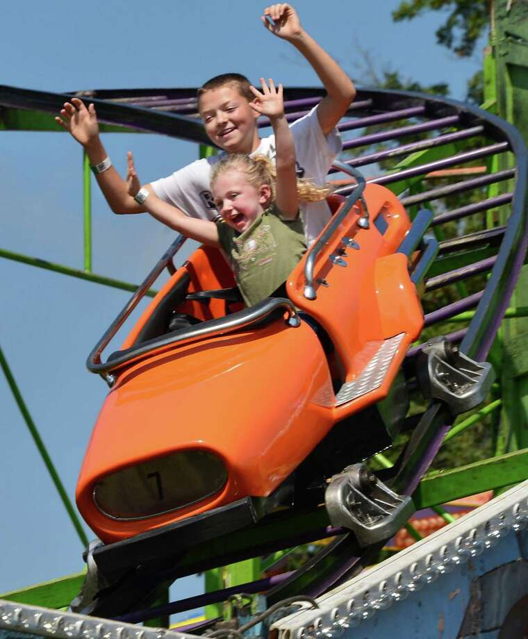 Dalton Russell, 12, of Schaghticoke, and cousin Peyton Carson, 4 of Stillwater ride the Indy 500 at the Schaghticoke Fair Friday Aug. 30, 2013, in Schaghticoke, NY.  (John Carl D'Annibale / Times Union) Photo: John Carl D'Annibale / 00023179A