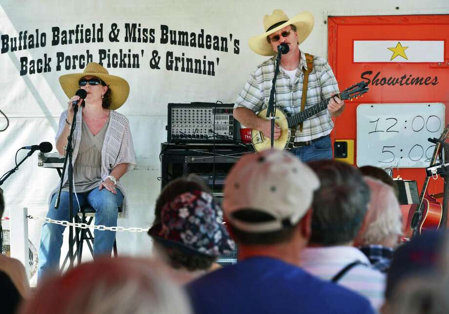 Michele Barfield, aka OMiss BumadeanO, left, and Gregg OBuffaloO Barfield perform at the Schaghticoke Fair Friday Aug. 30, 2013, in Schaghticoke, NY.  (John Carl D'Annibale / Times Union) Photo: John Carl D'Annibale / 00023179A