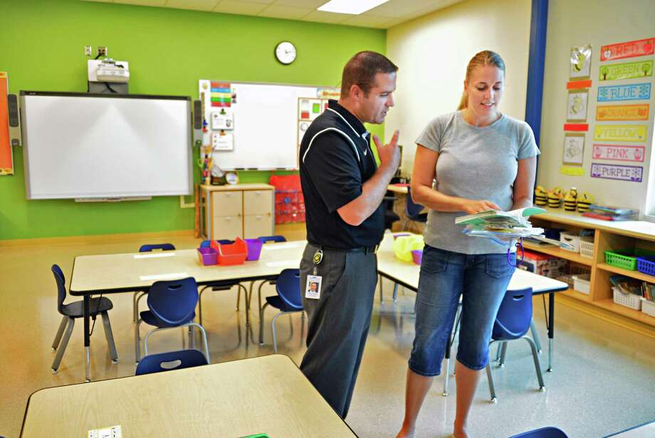 School principal Jeffrey Palmer, left, and kindergarten teacher Kristin Scott prepare for the new school year Thursday, Aug. 29, 2013, in Scott's classroom at Ballston Spa's new Gordon Creek Elementary School in Ballston Spa, N.Y. (John Carl D'Annibale / Times Union) Photo: John Carl D'Annibale / 00023677A