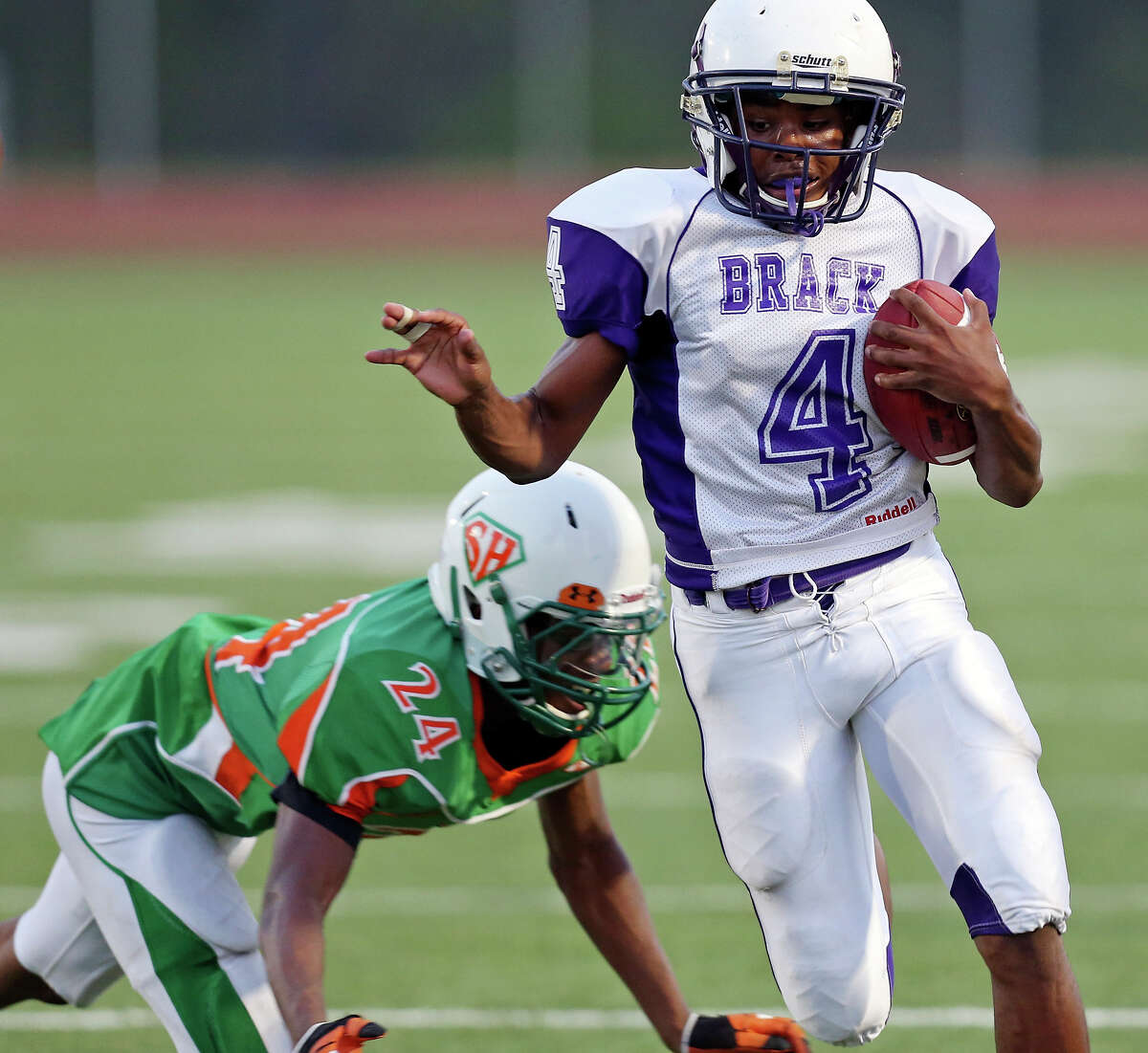 Brackenridge's Robert Allen looks for room around Sam Houston's Erin Mack during first half action Friday Aug. 30, 2013 at the Wheatley Heights Sports Complex.