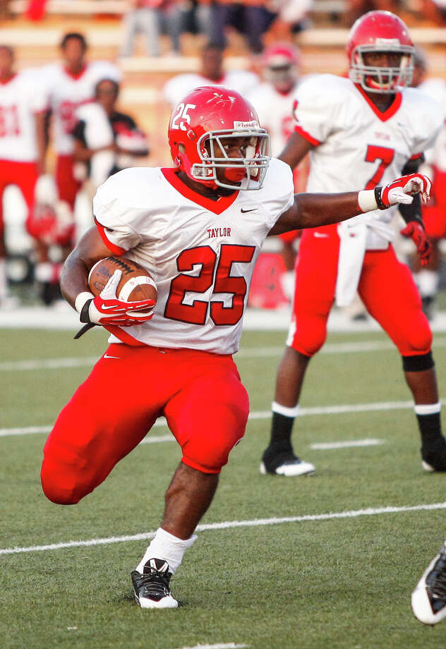 Alief-Taylor running back Kaleb Campbell (25) carries the ball during the first quarter of a high school football game at Butler Stadium on Friday, Aug. 30, 2013, in Houston, Texas. Photo: Andrew Richardson, For The Chronicle / © 2013 Andrew Richardson