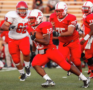Bellaire running back Reshard Waddel (12) carries the ball during the first quarter of a high school football game at Butler Stadium on Friday, Aug. 30, 2013, in Houston, Texas. Photo: Andrew Richardson, For The Chronicle / © 2013 Andrew Richardson