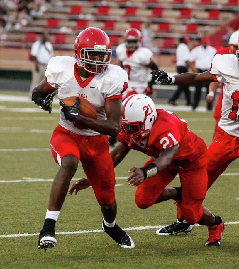 Alief-Taylor wide receiver Keenen Brown (8) breaks a tackle during the second quarter of a high school football game at Butler Stadium on Friday, Aug. 30, 2013, in Houston, Texas. Photo: Andrew Richardson, For The Chronicle / © 2013 Andrew Richardson