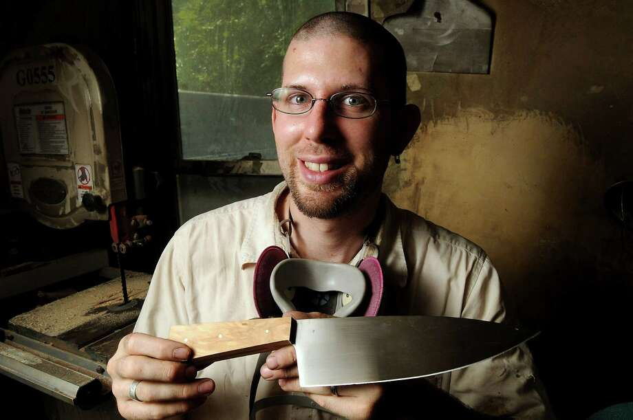 Russell Montgomery of Serenity Knives with a nearly completed knife in his Heights workshop Tuesday August 27, 2013.(Dave Rossman photo) Photo: Dave Rossman, Freelance / © 2013 Dave Rossman