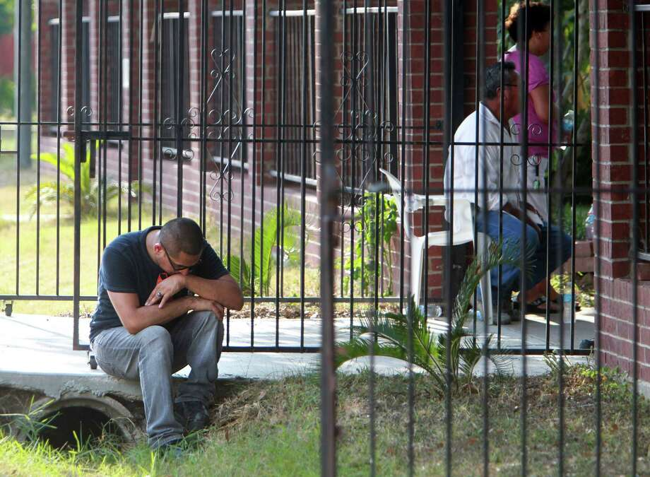 Miguel Velasquez, left, found the body of his grandfather, Juan Campos, in his backyard on Friday. The 96-year-old and his beloved Chihuahua, Choe, both appear to have been attacked by a one or more dogs. Photo: Mayra Beltran, Staff / © 2013 Houston Chronicle