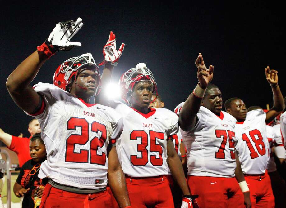 The Alief-Taylor Tigers sing their alma mater following the fourth quarter of a high school football game at Butler stadium on Friday, Aug. 30, 2013, in Houston. ( Andrew Richardson / For the Chronicle )  Alief-Taylor defeated Bellaire 22-9. Photo: Andrew Richardson, For The Chronicle / © 2013 Andrew Richardson