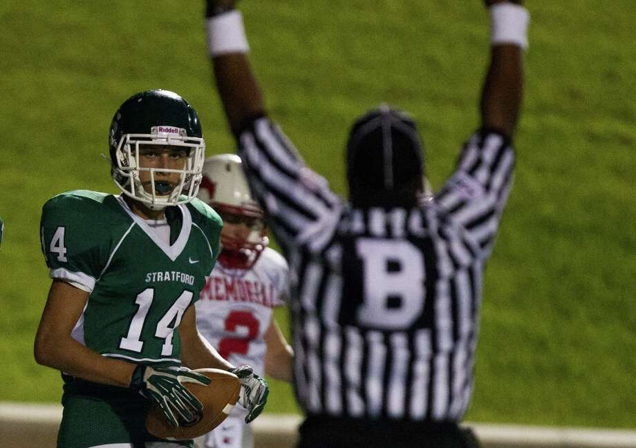 Stratford wide receiver Will Bredthauer (14) scores a touchdown during the second half of a high school football game against Memorial at Tully stadium on Friday, Aug. 30, 2013, in Houston. Photo: J. Patric Schneider, For The Chronicle / © 2013 Houston Chronicle