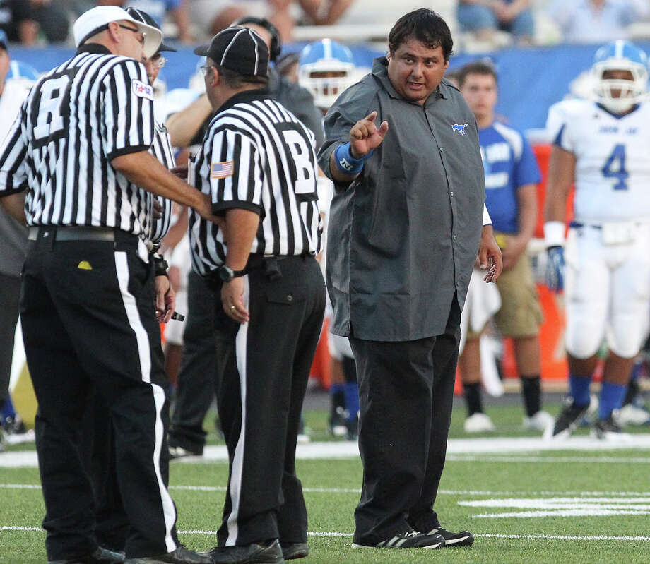 New John Jay head football coach Gary Gutierrez exchanges words with game officials during their game against East Central at East Central on Friday, Aug. 30, 2013. Photo: Kin Man Hui, San Antonio Express-News / ©2013 San Antonio Express-News