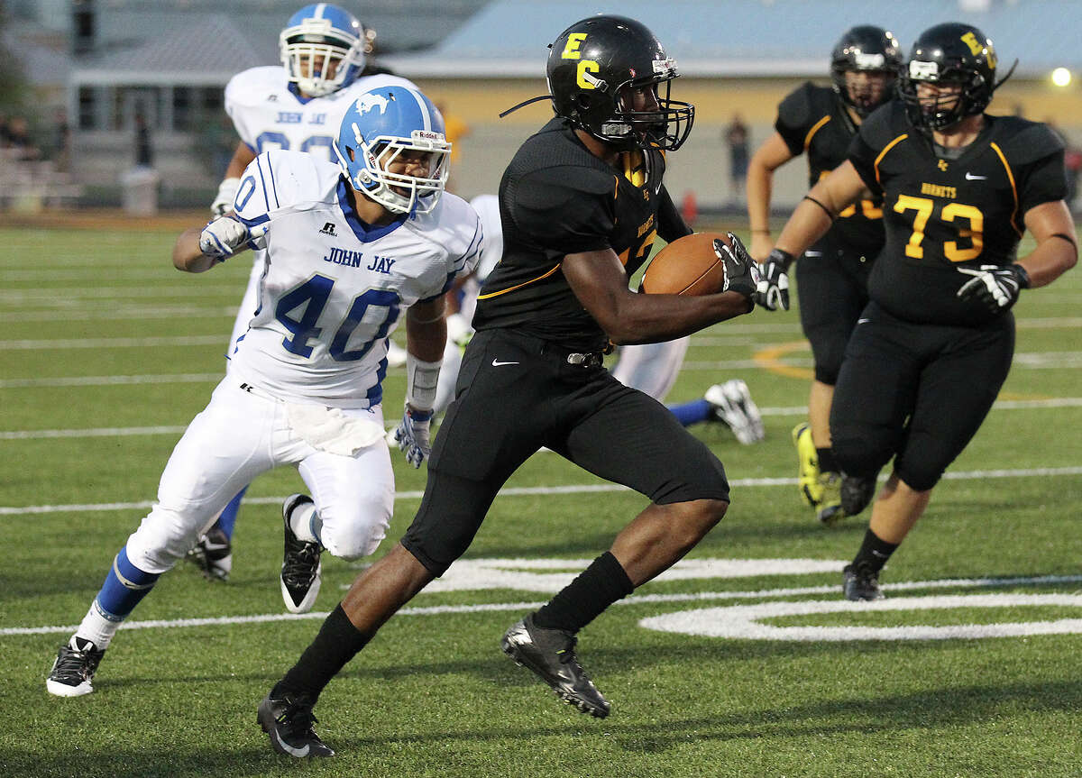 East Central's Johnathan Jackson (13) runs upfield against John Jay's Luis Trujillo (40) during their game at East Central on Friday, Aug. 30, 2013.