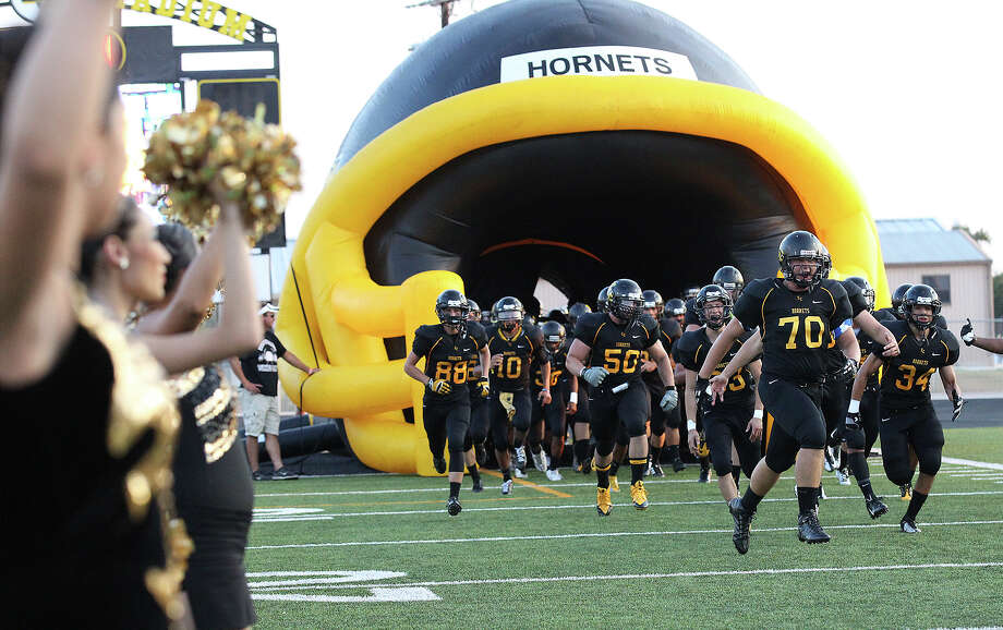 The East Central Hornets take the field for football against John Jay at East Central on Friday, Aug. 30, 2013. Photo: Kin Man Hui, San Antonio Express-News / ©2013 San Antonio Express-News