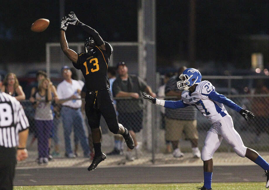 East Central's Johnathan Jackson (13) is unable to make a catch in the end zone against John Jay's Tre Fontenot (27) during their game at East Central on Friday, Aug. 30, 2013. Photo: Kin Man Hui, San Antonio Express-News / ©2013 San Antonio Express-News