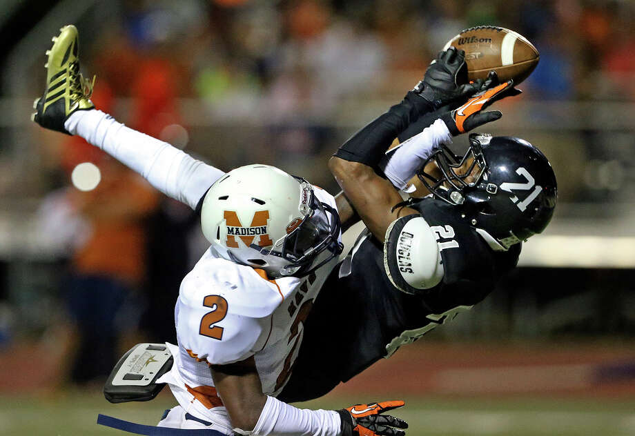 Knight receiver D'Angelo Wallace snares a pass at the one yard line over Latrell Sledge setting up a touchdown on the next play as Steele hosts Madison at Lehnhoff Stadium on August 30, 2013. Photo: TOM REEL, San Antonio Express-News / San Antonio Express-News