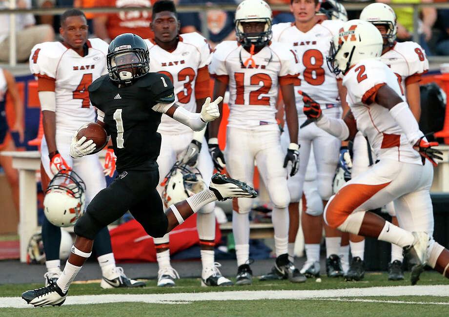 Knight return specialist Jaylen Harris returns a kickoff for a touchdown as Steele hosts Madison at Lehnhoff Stadium on August 30, 2013. Photo: TOM REEL