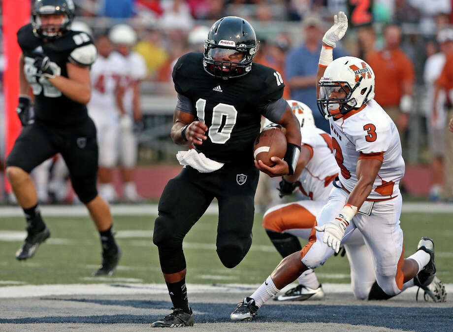 Knight quarterback LG Williams takes off on a long run up the middle in the first half as Steele hosts Madison at Lehnhoff Stadium on August 30, 2013. Photo: TOM REEL