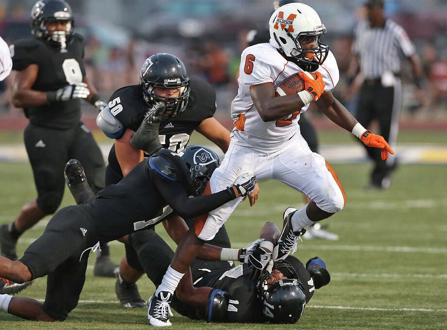 The Maverick's Dominique Daniels plows through for yardage as Steele hosts Madison at Lehnhoff Stadium on August 30, 2013. Photo: TOM REEL
