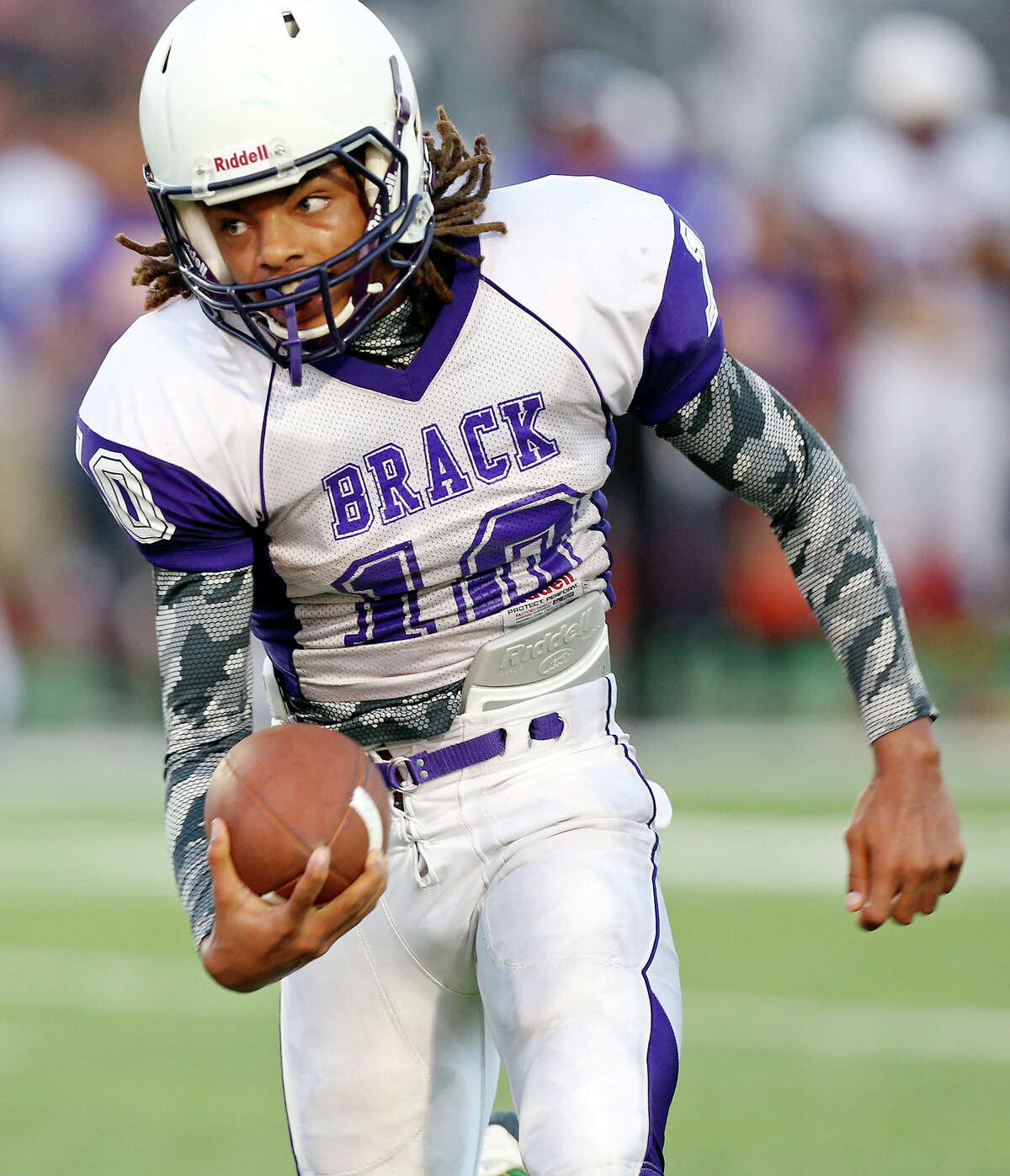 Brackenridge's Ramon Richards heads up field against Sam Houston during first half action Friday Aug. 30, 2013 at the Wheatley Heights Sports Complex.