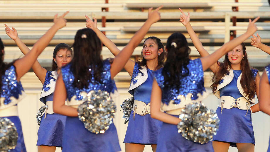 John Jay dance team members gesture during the school song before the game against East Central at East Central on Friday, Aug. 30, 2013. Photo: Kin Man Hui, San Antonio Express-News / ©2013 San Antonio Express-News
