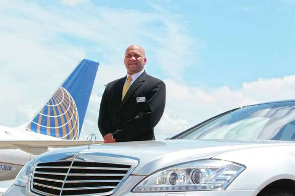 Reggie Christian is ready to drive special passengers in a Mercedes. He helps members of United Airlines' Global Services, an invitation-only program.