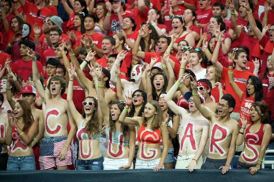 University of Houston fans cheer as their team takes on Southern. Photo: Smiley N. Pool, Houston Chronicle / © 2013  Houston Chronicle