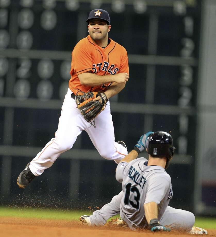 Aug. 30: Mariners 7, Astros 1Astros second baseman Jose Altuve tries to make a play on defense against the Mariners. Photo: Karen Warren, Houston Chronicle
