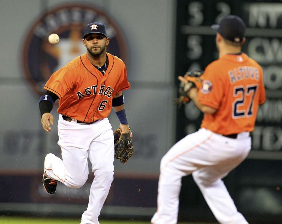 Astros shortstop Jonathan Villar tosses the ball to second baseman Jose Altuve. Photo: Karen Warren, Houston Chronicle