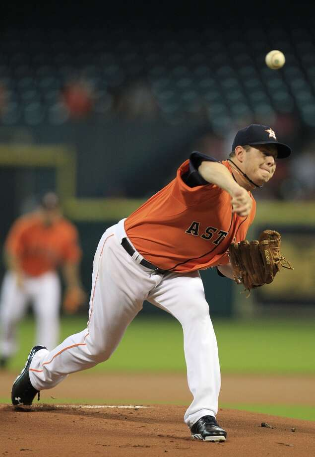 Astros pitcher Brad Peacock delivers a throw to the Mariners. Photo: Karen Warren, Houston Chronicle