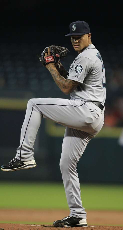 Mariners pitcher Taijuan Walker makes a throw to the Astros. Photo: Karen Warren, Houston Chronicle