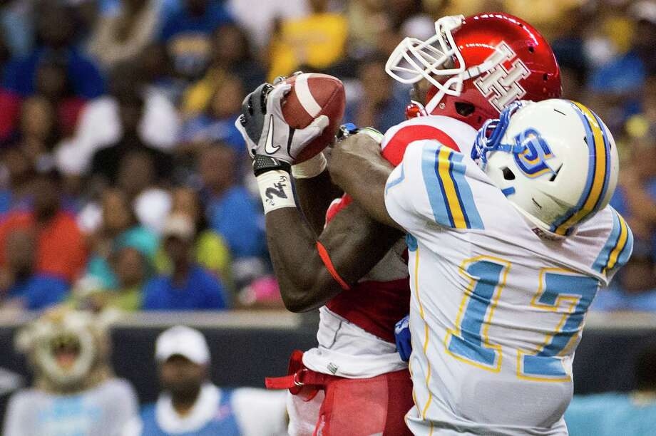 Houston wide receiver Deontay Greenberry pulls in a 10-yard touchdown catch as Southern defensive back Omar Cook (17) defends.. Photo: Smiley N. Pool, Houston Chronicle / © 2013  Houston Chronicle